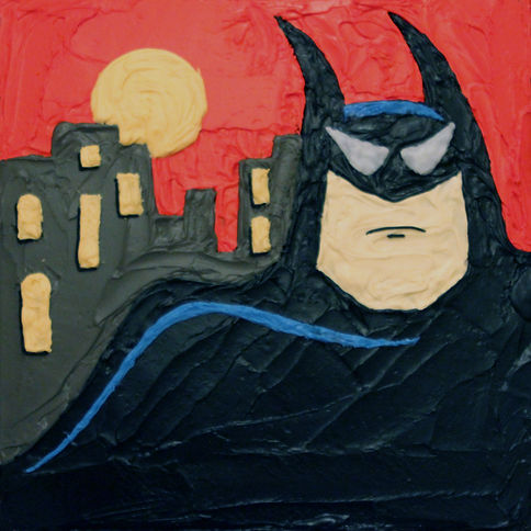 Batman from the animated series drawn onto a cake using frosting