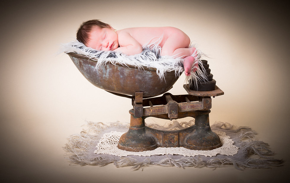 newborn baby photo shoot with scales prop