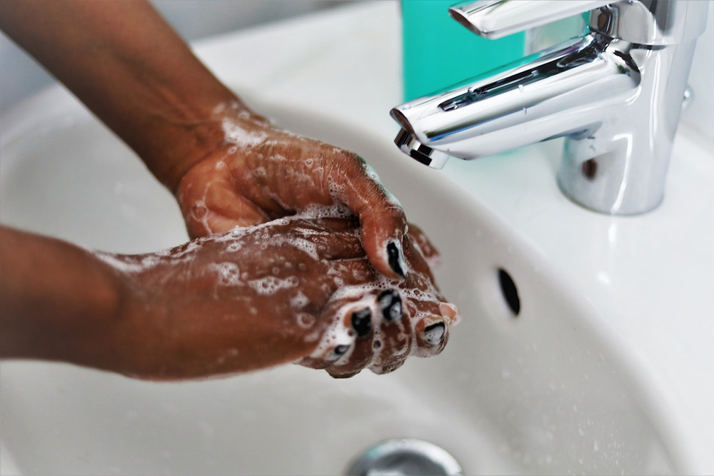 Woman washing hands at the sink
