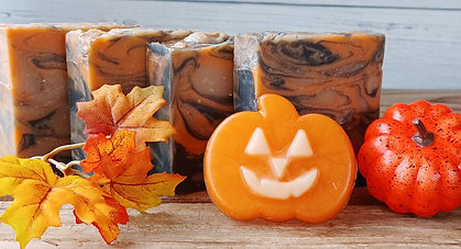 4 pumpkin pie soaps with a jack o'lantern soap in front, autumn leaves and a small pumpkin