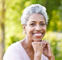 Smiling woman with silver hair