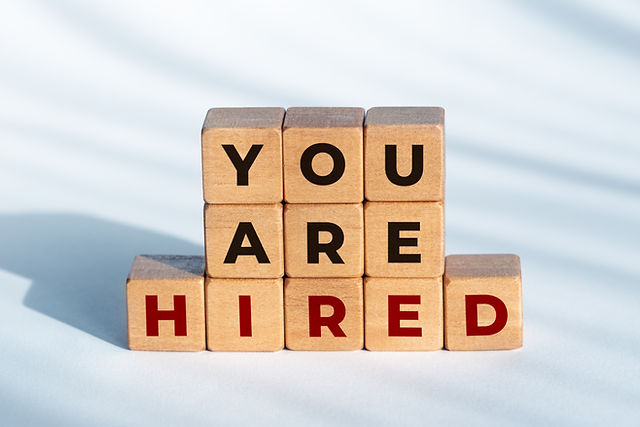 you-are-hired-phrase-wooden-dices-employ