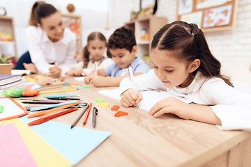 children-write-notebooks-with-pen.jpg