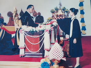 Attorney Chestapanich receiving her law degree from King Bhumibol Adulyadej