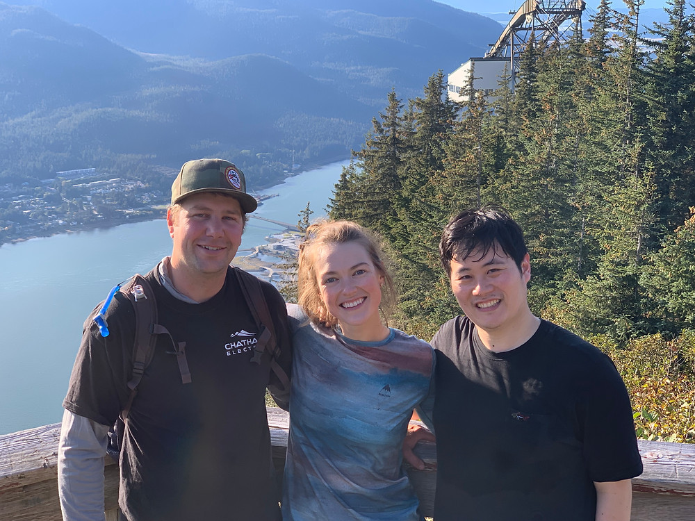 [Spectacular Fall day in Juneau with 3 friends smiling near the top of Mt. Roberts]