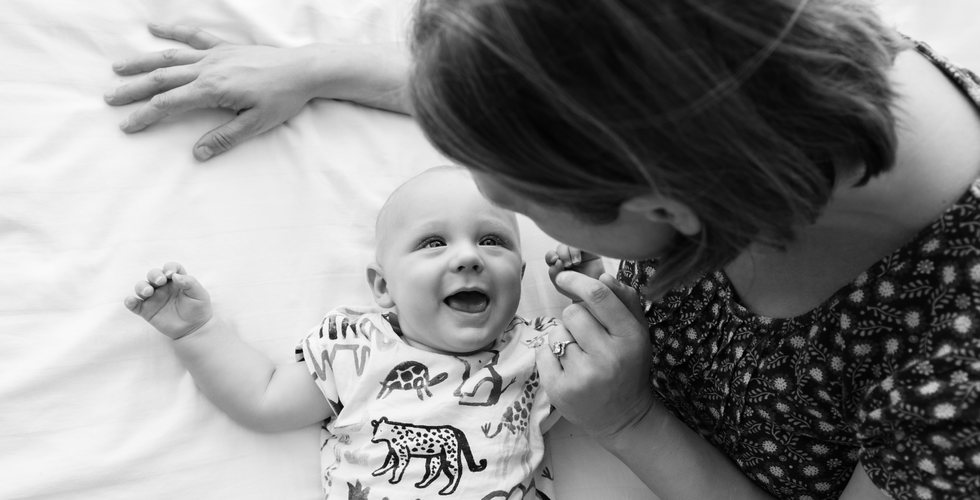 mother and 6 month old smiling baby photography in black and white