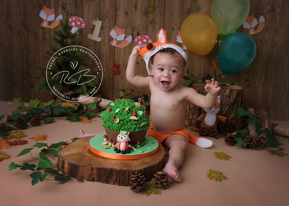 Baby boy in fox costume for cake smash photo shoot