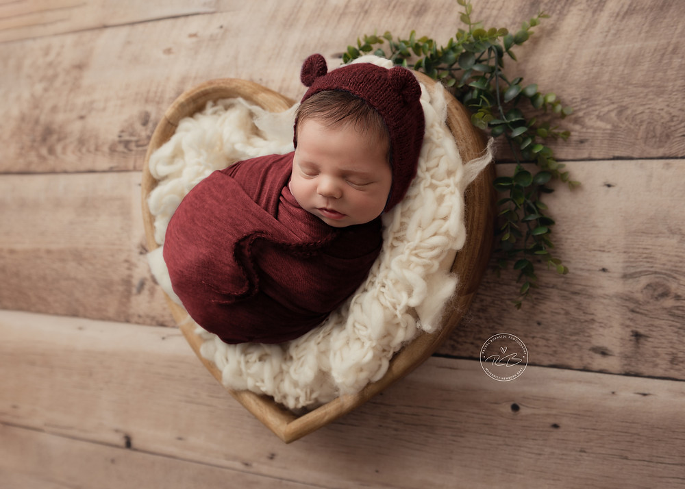 Newborn baby photography in heart bowl