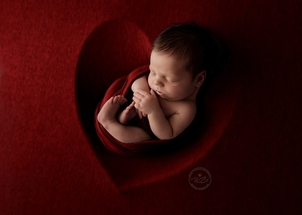 Newborn Baby fine art photography in red heart