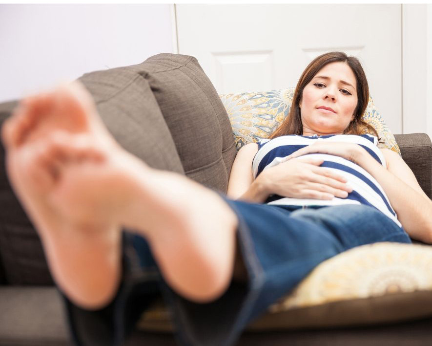 Pregnant woman with feet up