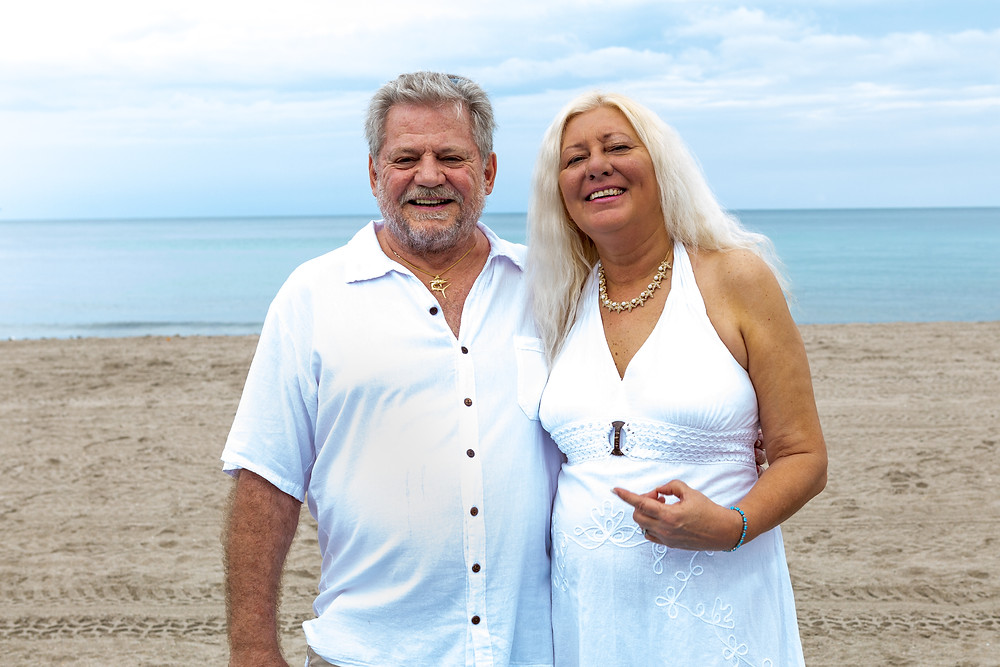 Cincinnati wedding photographer captures image of elder husband and wife smiling posing for a picture in the beach.