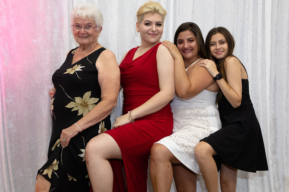 Miami wedding photographer captures image of women posing for a wedding picture.