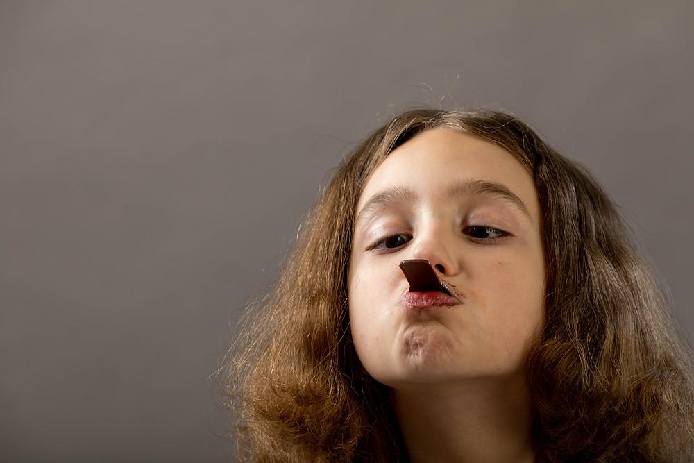 Cincinnati portrait photographer captures girl eating chocolate ice cream.