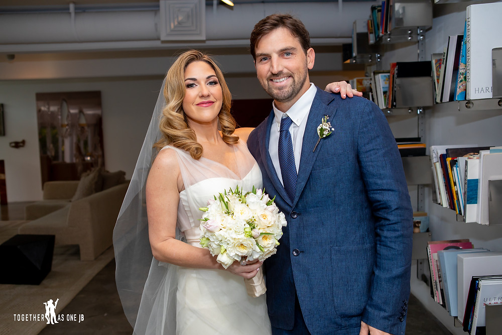 Bride posing with brother before walks down aisle in the M Building in Wynwood