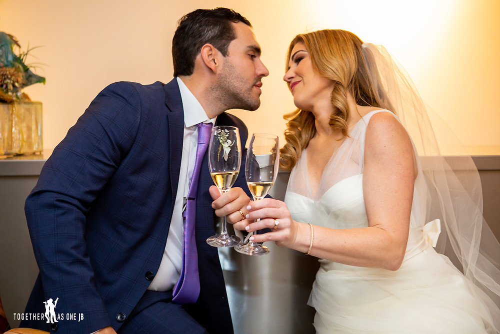 Bride and Groom celebrating with Champagne in the M Building in Wynwood