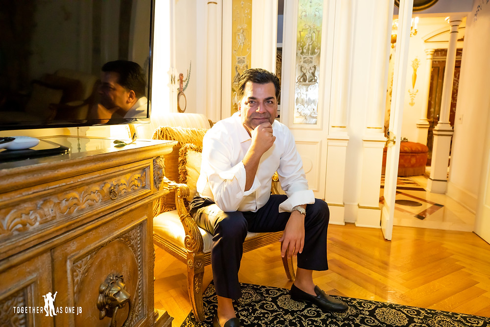 Groom sits patiently in bedroom of the former Versace Mansion
