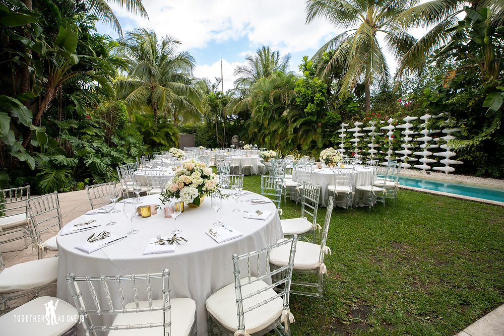 Wedding tables at outdoor reception at the M Building in Wynwood