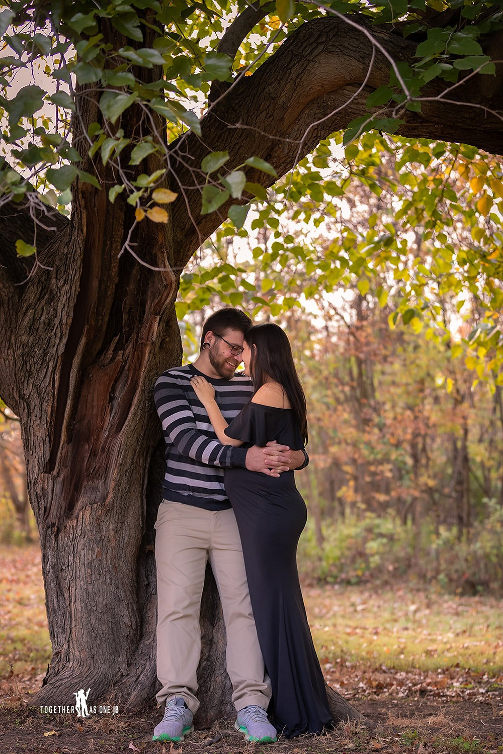 Cincinnati wedding photographer captures portrait of couple holding each other smiling in the woods.