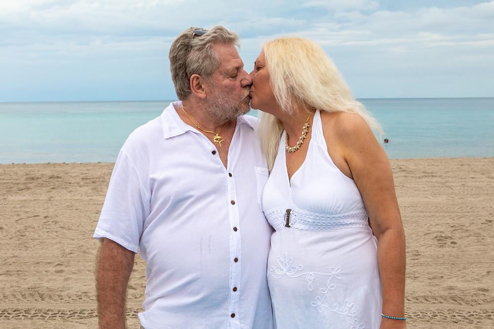 Cincinnati wedding photographer captures image of husband and wife kissing on the beach.
