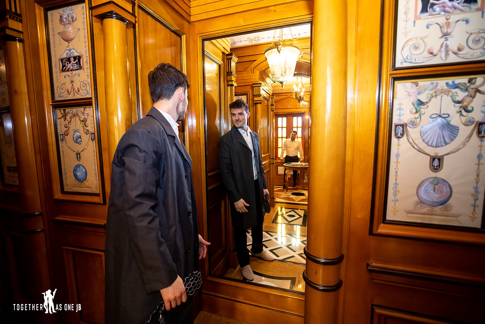 Groom playing dress up in Gianni's huge walk-in closet at former Versace Mansion