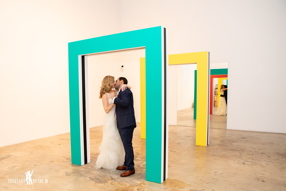 Bride and Groom kissing in art installation in the M Building in Wynwood