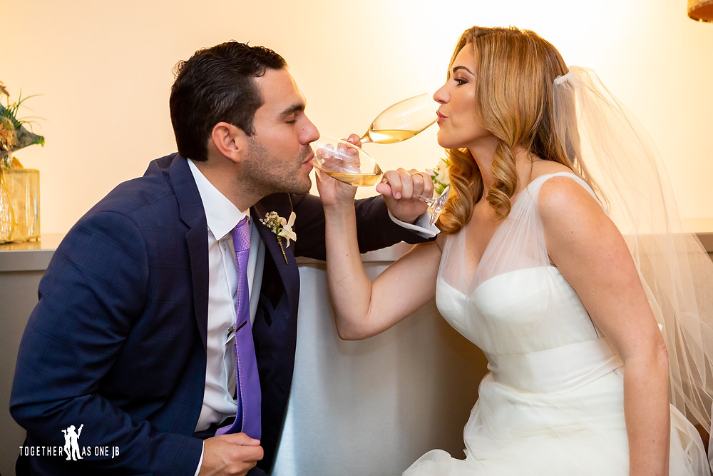 Bride and Groom drinking champagne in the M Building in Wynwood