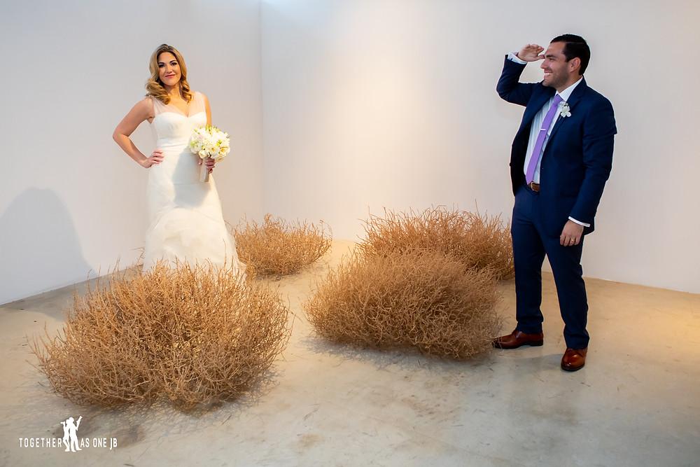 Groom looking for Bride in tumbleweed art installation in the M Building in Wynwood