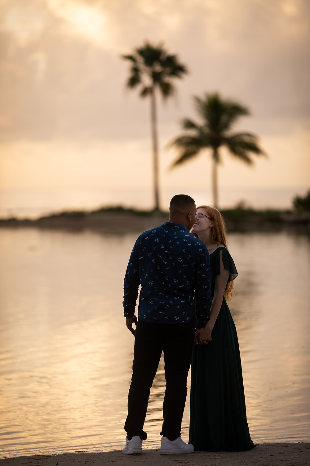 Miami wedding photographer captures image of couple kissing in the beach.