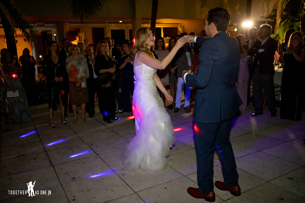 Wedding couple dancing first dance at wedding reception in the M Building in Wynwood
