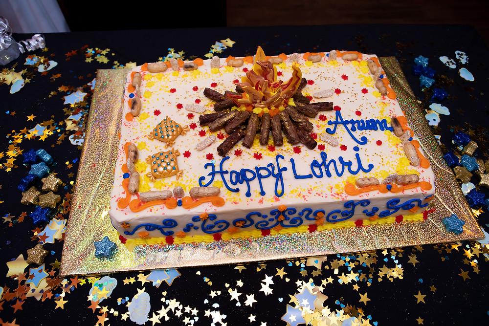 Indian birthday photographer captures image of birthday lohri cake.