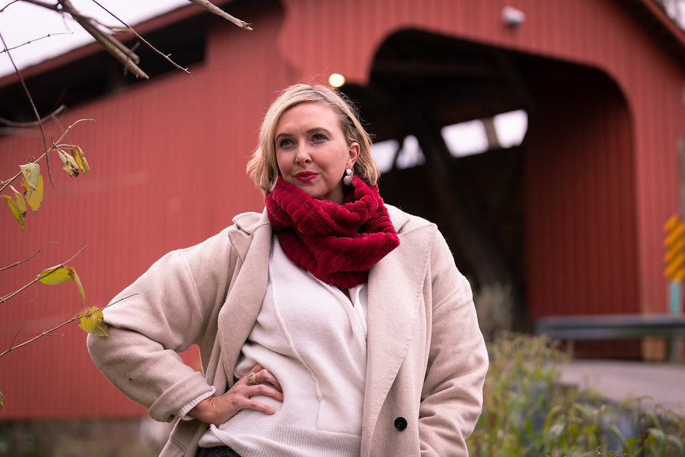 Cincinnati portrait photographer captures image of woman with winter clothes posing for a picture.