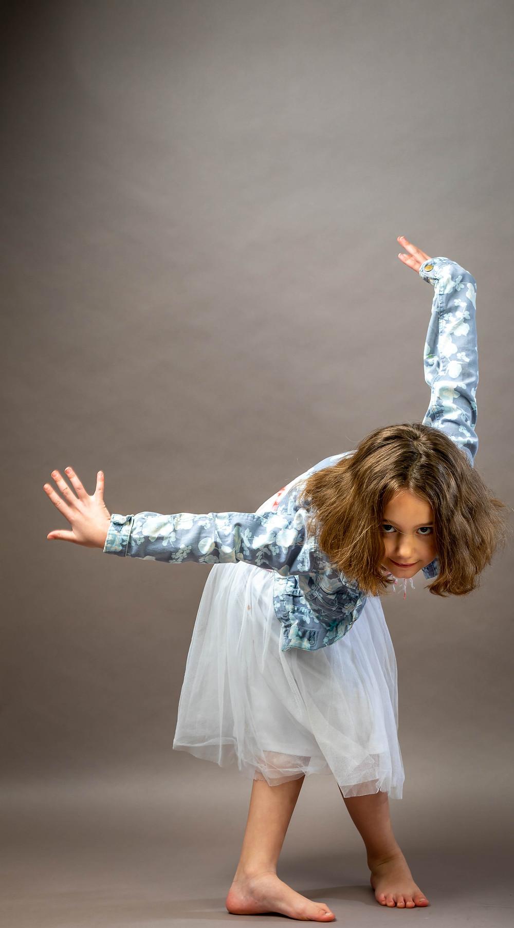 Cincinnati portrait photographer captures girl striking a dancing pose.