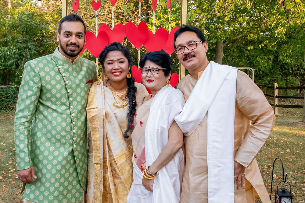 Indian wedding photographer captures image of indian family in wedding smiling.
