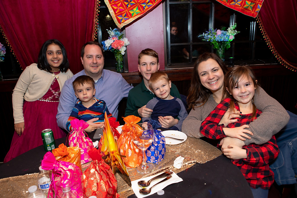 Indian birthday photographer captures image of family posing for a picture in lohri birthday.