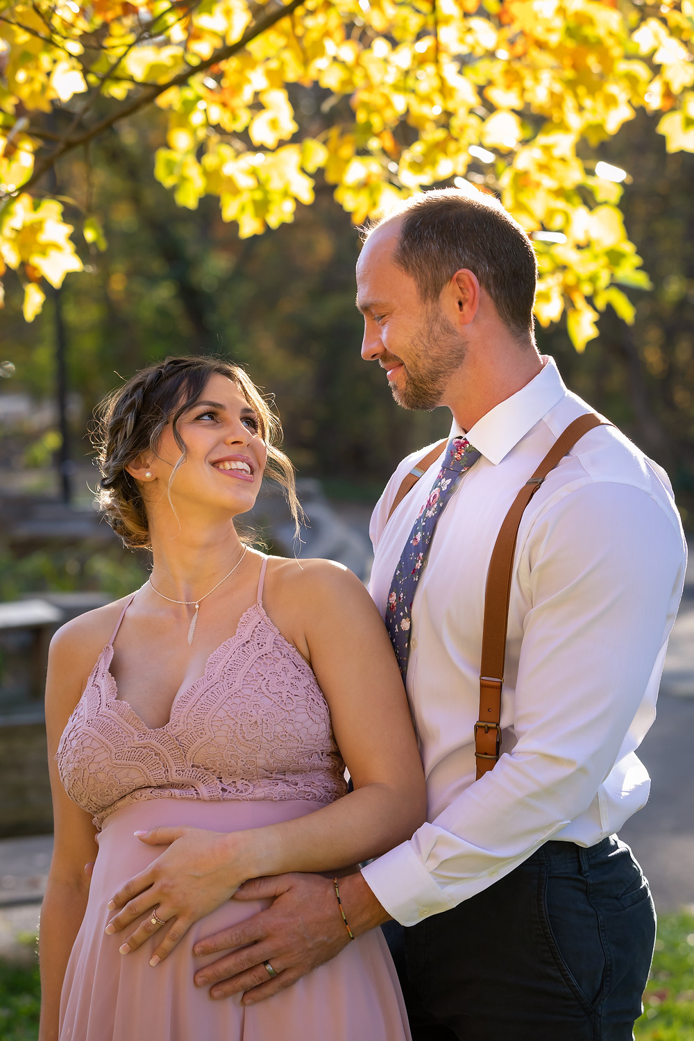Cincinnati wedding photographer captures image of groom caressing bride's pregnant belly smiling.