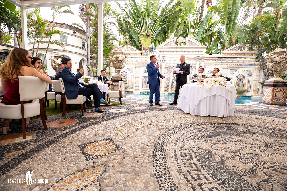 Best man give wedding toast to wedding couple during a formal dinner at the Villa Casa Casuarina