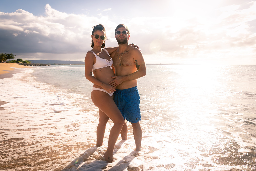 Engagement wedding photographer captures image of couple posing for a picture in the beach in Puerto Rico.