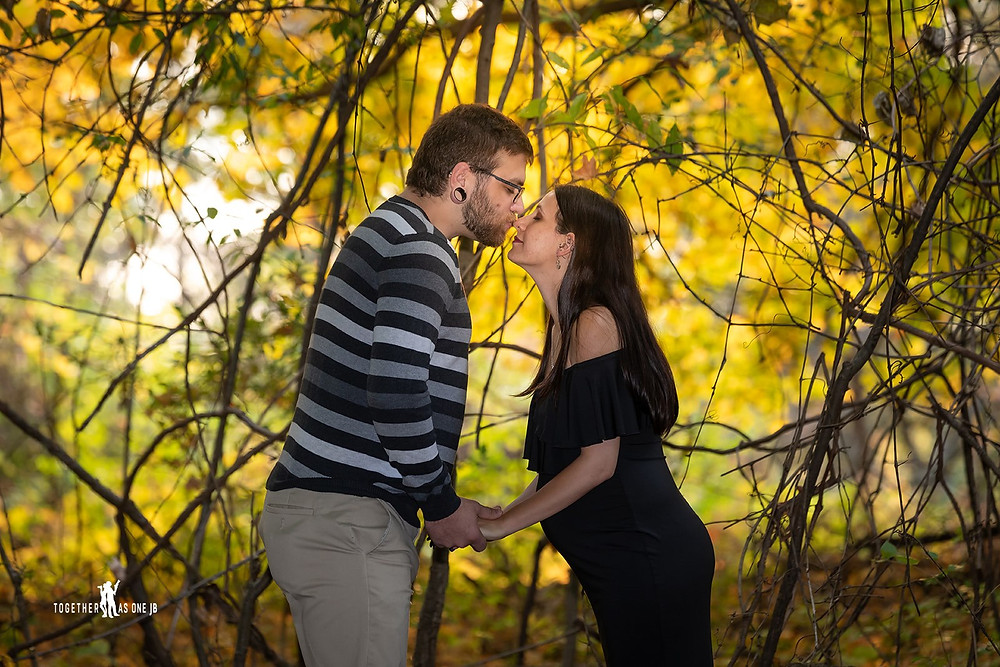 Cincinnati wedding photographer captures photograph of man kissing nose of woman in the woods.