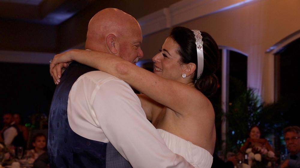 Cincinnati wedding photographer captures image of married couple dancing smiling.