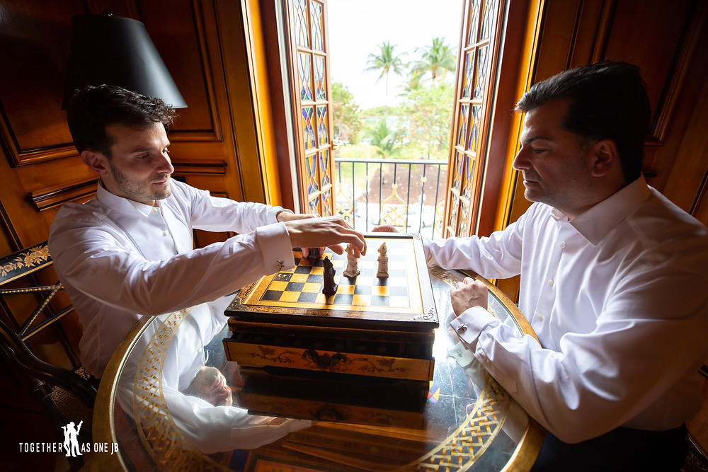 Grooms playing chess in Miami's South Beach Wedding Venue