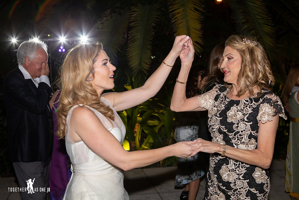 Mother of the Bride dancing with Bride at wedding reception at the M Building in Wynwood