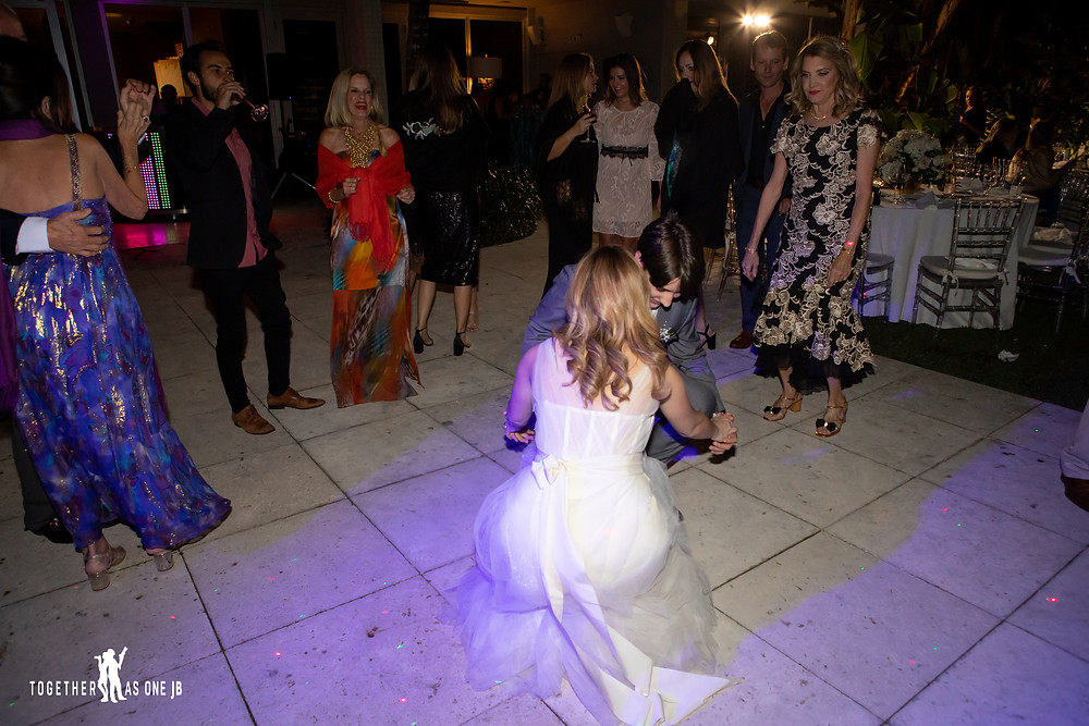 Bride dancing with brother in law at wedding reception at the M Building in Wynwood