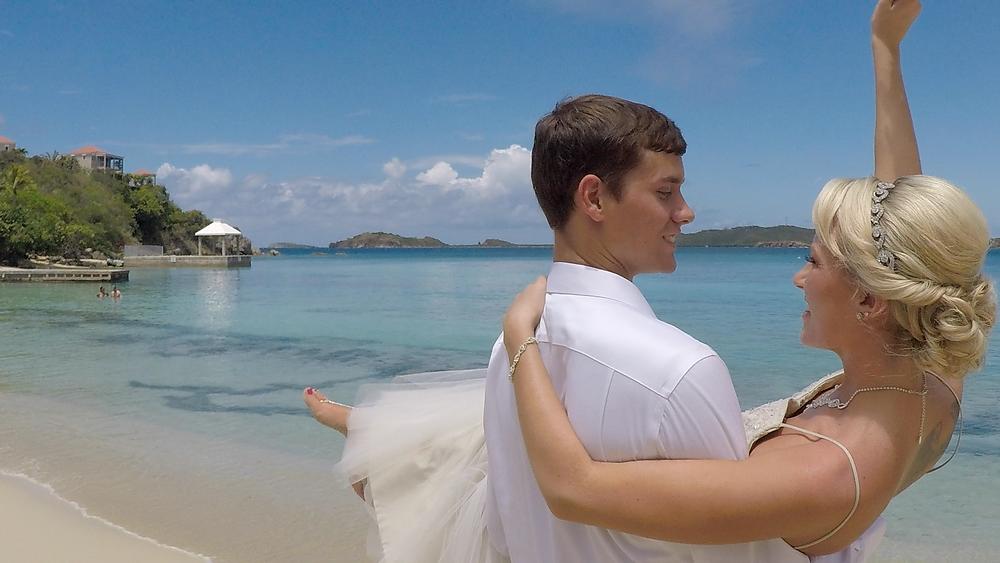 Cincinnati wedding photographer captures image of husband carrying wife in the beach.