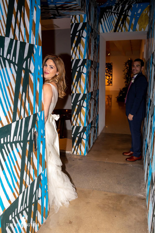 Groom looking at Bride in front of wall mural in M Building in Wynwood