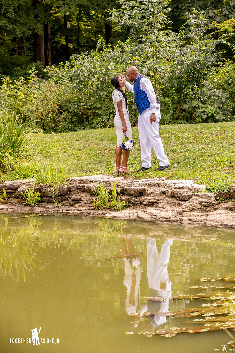Bride and Groom about to kiss with their reflection in lake at Mt. Airy park in Cincinnati after their small intimate wedding in Ohio