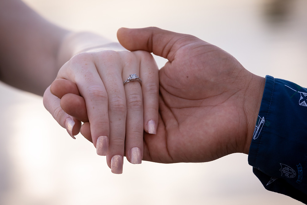 Miami wedding photographer captures image of hand of bride and groom engagement ring.