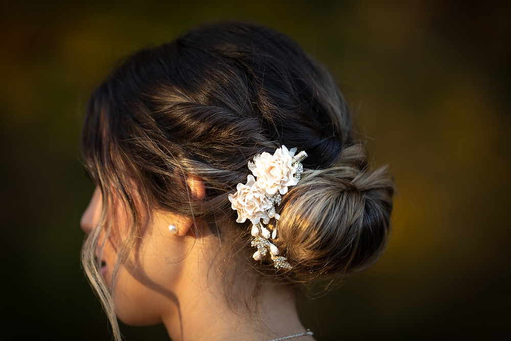 Cincinnati wedding photographer captures image white flowers in bride's hair of