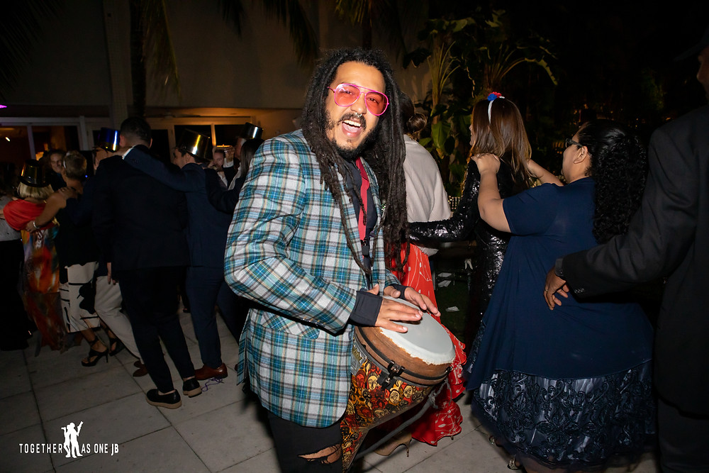 Musician playing his drum enjoying Hora Loca during wedding reception at the M Building in Wynwood