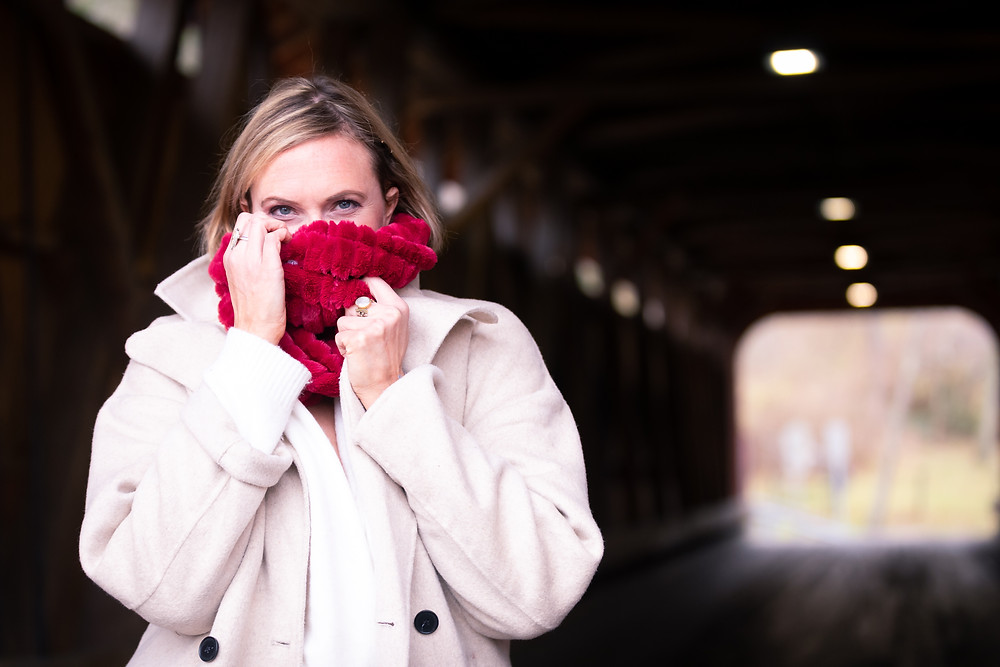 Cincinnati portrait photographer captures image of woman covering mouth with scarf at the end of a tunnel.