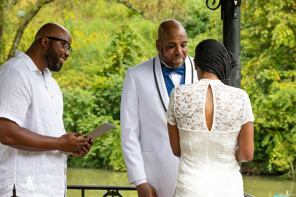 Close up of wedding couple with officiant during wedding ceremony at Mt. Airy Park in Cincinnati